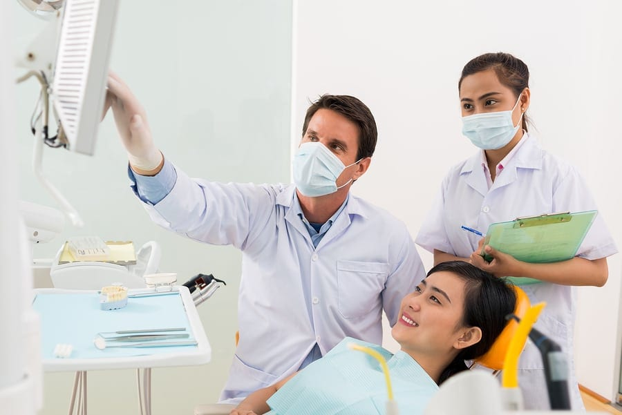 orthodontist and assistant with a patient