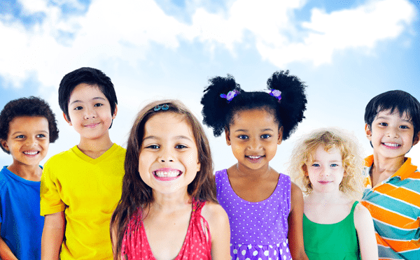 diverse group of young children smiling outside