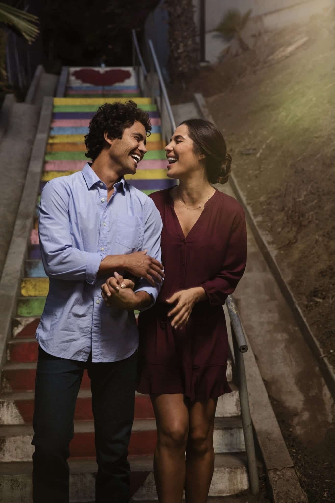 Happy couple walking down stairs Invisalign