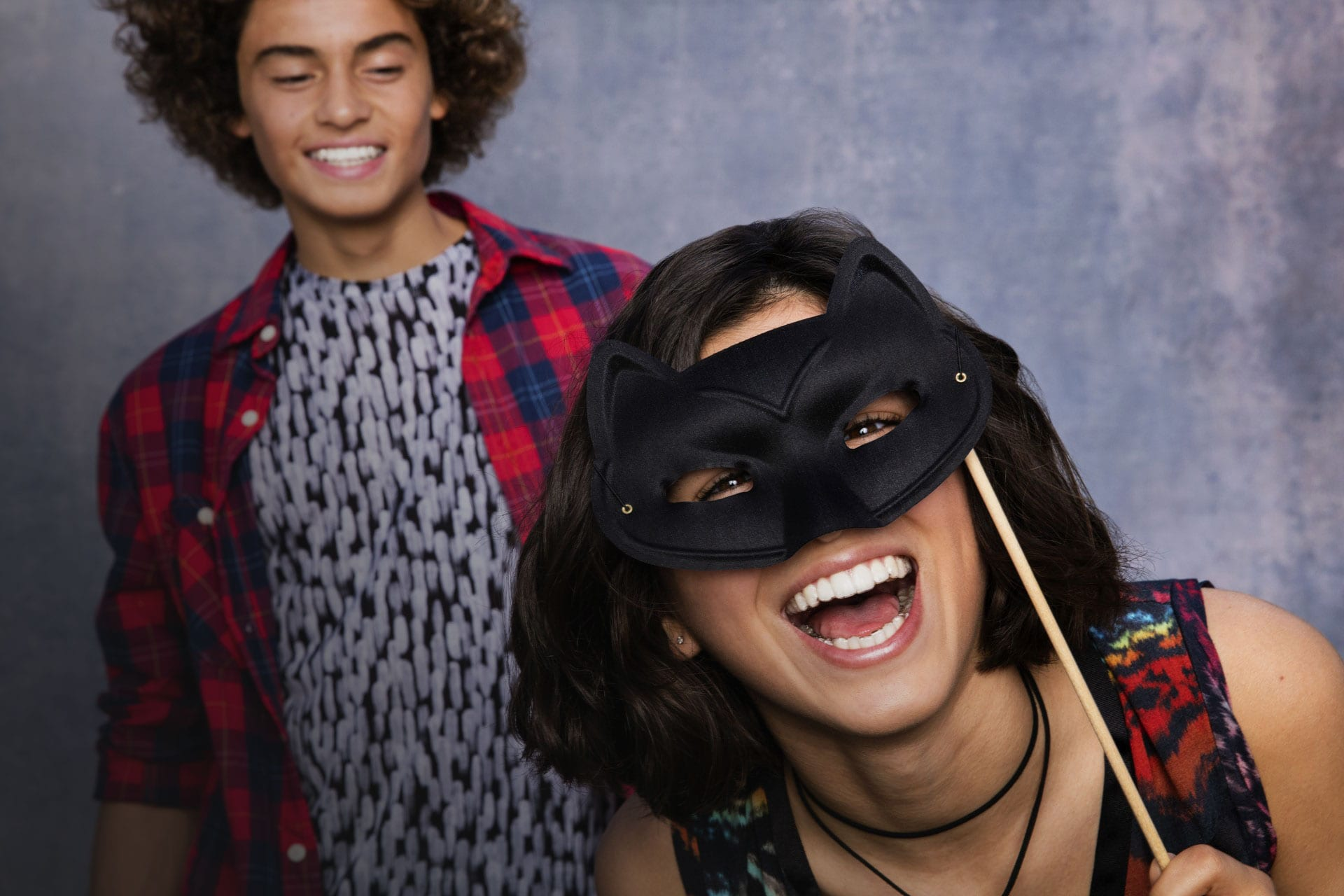 teens in a photo booth with mask wearing Invisalign Teen aligners