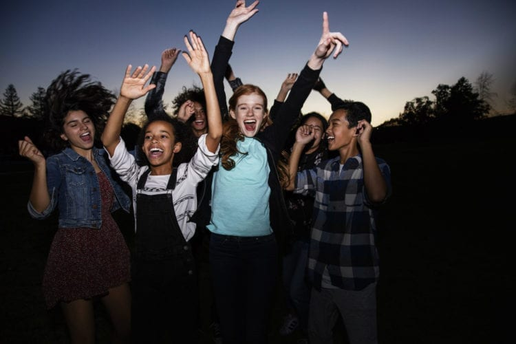teens dancing at dusk wearing Invisalign Teen