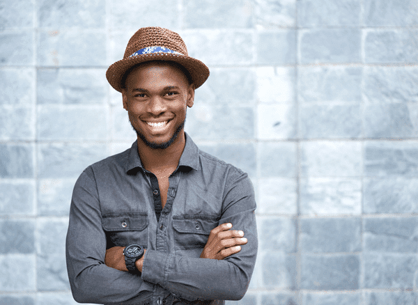 young man wearing a hat and smiling